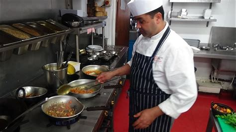 Busy Chef At Work Action Inside An Indian Restaurant