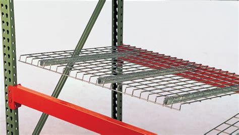 husky rack and wire wire decking being placed into pallet rack