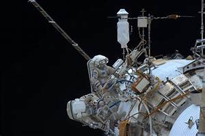 Space station cosmonauts conduct spacewalk to install ...
