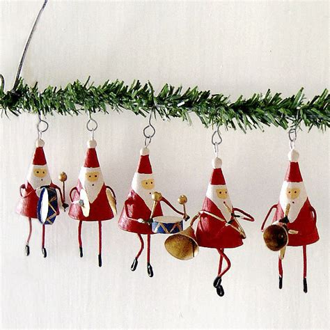 father christmas band hanging garland by red lilly