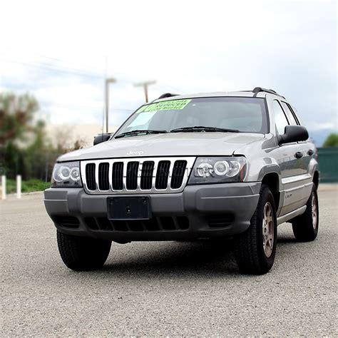 jeep black headlights 99 04 jeep grand cherokee dual halo led projector
