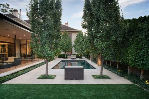 Pool And Patio Ideas pool fence ideas spaces with brick pool deck chimney1