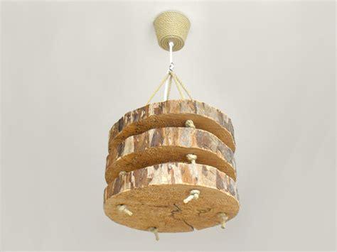 lamp voor de kinderkamer gemaakt van plakken boomstam en