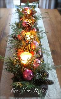 old box filled with vintage glass ornaments pine candles in glass holders pine cones for a