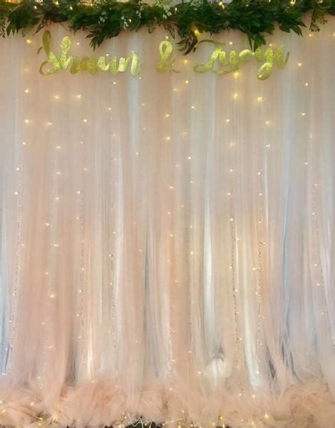 blush tulle backdrop  artificial foliage  fairy