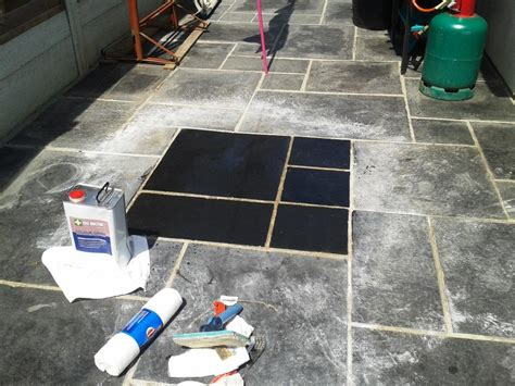 cleaning and sealing a black limestone patio in broadstone