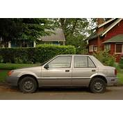 OLD PARKED CARS 1989 Geo Spectrum