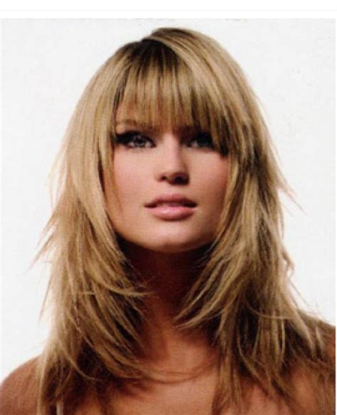 long full layered woman hairstyle with long bangs png