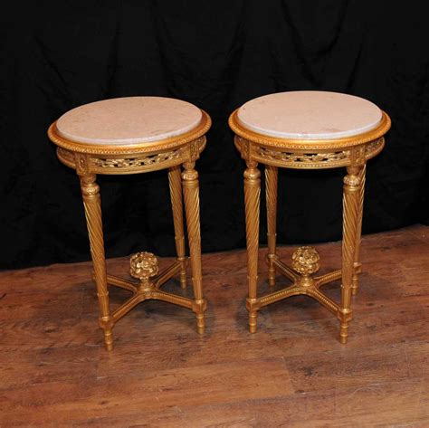 Beautiful walnut coffee table of empire design. Pair French Empire Gilt Side Cocktail Tables