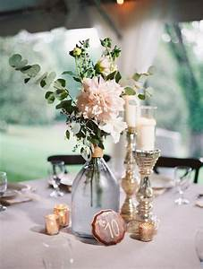 Picture Of spring tablescape with blush florals, candles