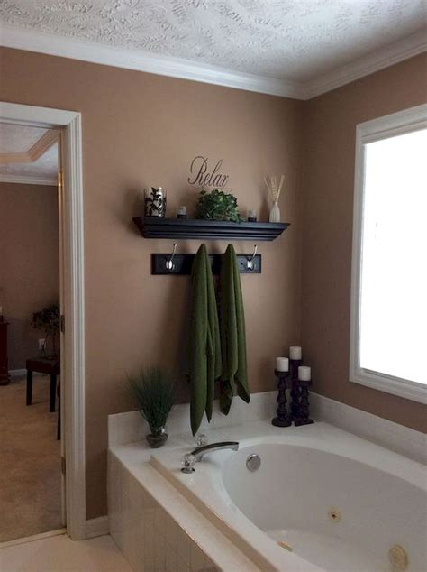 The most common bathroom wall decor material is stretched canvas. 59 Best Farmhouse Wall Decor Ideas for Bathroom (57) - Ideaboz