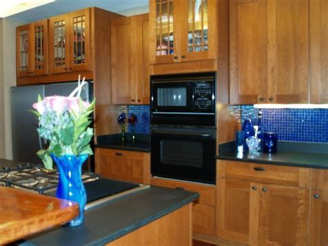 cobalt blue glass backsplash   , honed black granite