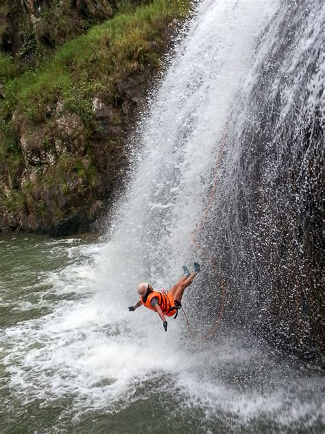 Dalat Canyoning Tour: surfing the waterfalls in a canyon