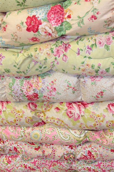 shabby chic textiles a pile of vintage eiderdowns cottage bedrooms pinterest vintage quilts and vintage quilts
