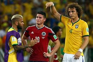 James Rodriguez is consoled by David Luiz and Dani Alves ...