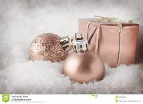 pale pink christmas decorations in snow stock photo image 45060611