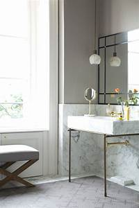 Small petal like pendant light above a marble sink decoist