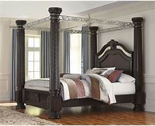 Laddenfield Cal King Poster Canopy Bed B717 50 51 62 72 95 Ashley Cafe Noir Four Poster Bedroom Set With Iron Canopy California King Canopy Bedroom Sets Mooz Paper Home Ideas California King Canopy Bedroom Set Home Design Ideas
