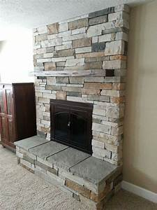 Fireplace remodel cultured stone new insert raised for Faux stone fireplace hearth