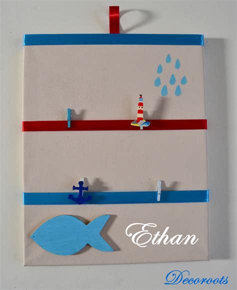 tableau chambre bébé garçon pêle mêle enfant bébé garçon thème mer beige bleu