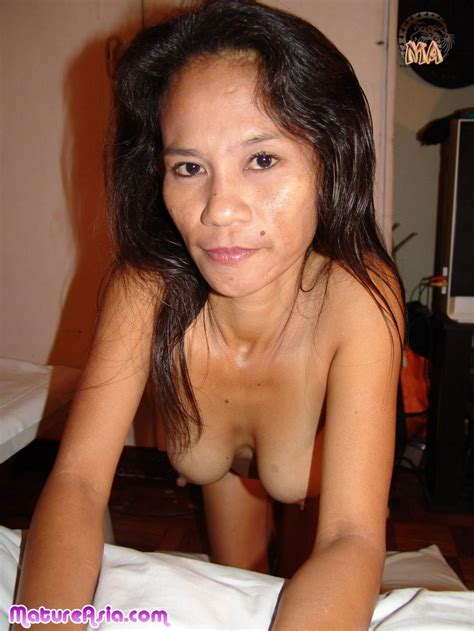 Old skinny Asian granny from the Philippines has a great set of tits