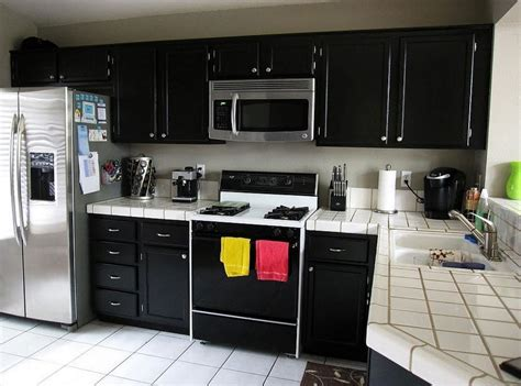 kitchen ideas with stainless steel appliances white ceramic countertop and corner black cabinet for