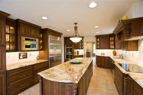 what color countertops go with oak cabinets oak cabinets and white granite counters granite