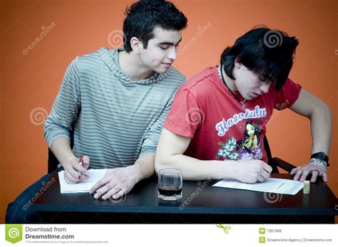 guy cheating  exam royalty  stock images image