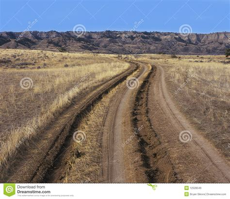 Rugged Environment by Tire Track And Ruts In Dirt Road Royalty Free Stock Images