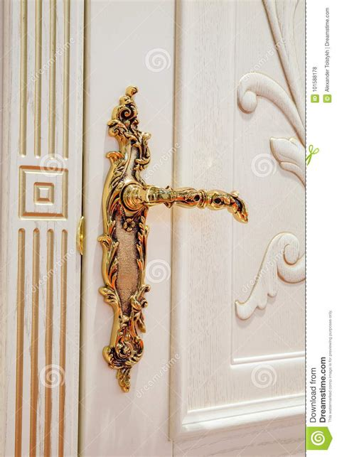 white door with golden lock stock photo image 101588178