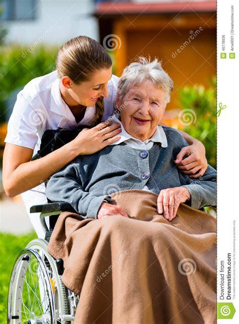 senior woman  nursing home  nurse  garden stock