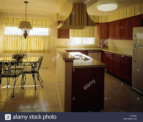 1970s KITCHEN AND DINING AREA WITH YELLOW STRIPED CURTAINS