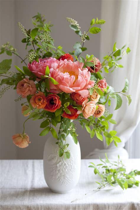 gorgeous peony ranunculus arrangement scarlets table