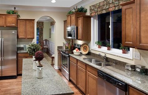 tiered cabinetry  crown moulding  large family kitchen   farmington  dominion homes