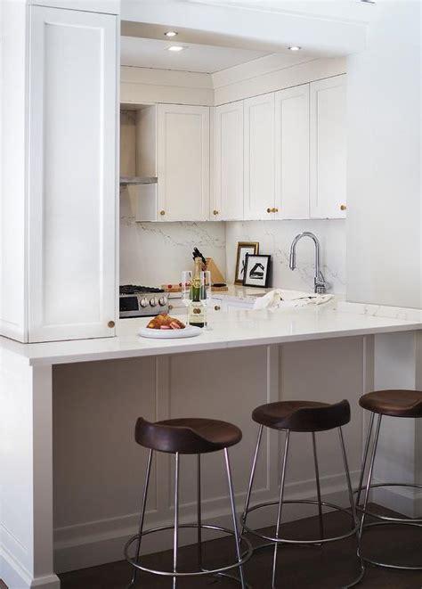 small white kitchen  mini brass  glass pendant lights contemporary kitchen