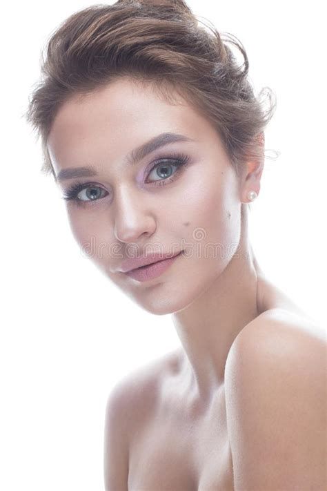 Young Girl With A Gentle Nude Makeup And Hairstyle
