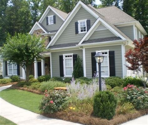 the gray siding with white trim and navy