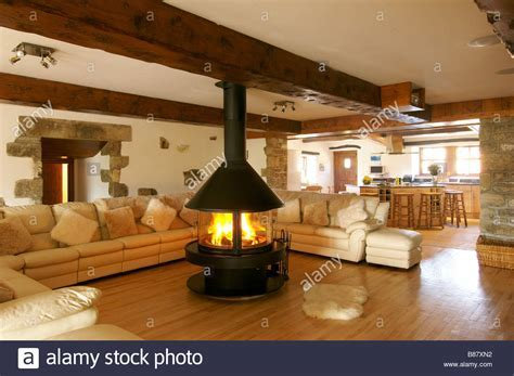 living room with large corner sofa and central fireplace
