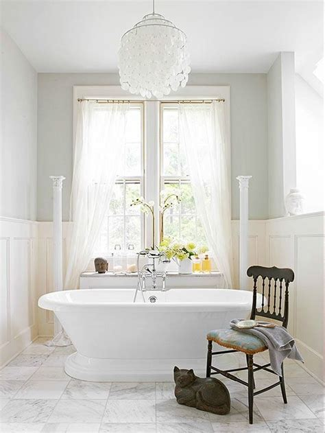 light filled bathroom  capiz shell chandelier
