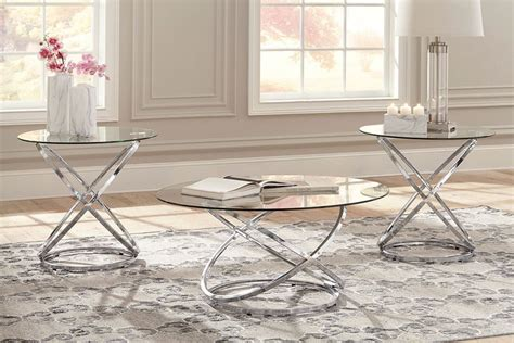 Its unique design features a moveable glass top and timber base working well in an ultra modern or eclectic style setting. Hollynyx Chrome Three Piece Cocktail Tables | Unclaimed Freight Furniture
