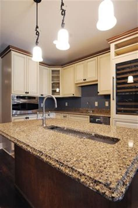 white cabinets with oak trim oak trim white cabinets paint the trim or leave it 334 | 66a03cd96cbba7e52961d1d14ed15618