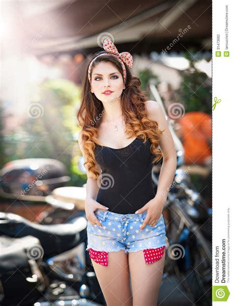 The Pin up Beautiful Girl With Long Hair Outdoor Growth