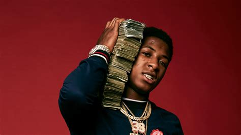 Nba Youngboy In Red Background With Money Bundle On Neck
