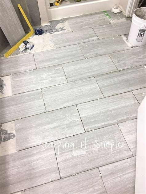12x24 Tile Bathroom by How To Tile A Bathroom Floor With 12x24 Gray Tiles In 2019