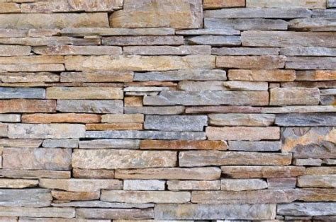 Wall covering stones are supplied by us are highly demanded for interior and exterior wall.we offering around 300 designs in 15 natural colors. Stock Photo   Stacked stone walls, Stone wall panels ...