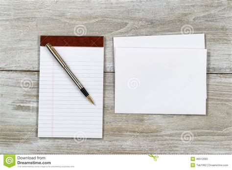 letter writing materials  wooden desktop stock photo