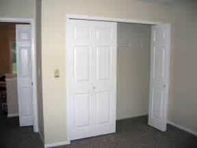 white wooden with shoes and three drawers of closet