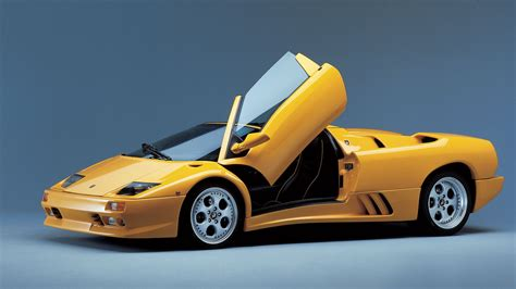 Yellow Lamborghini Car With Doors Open - 9to5 Car Wallpapers