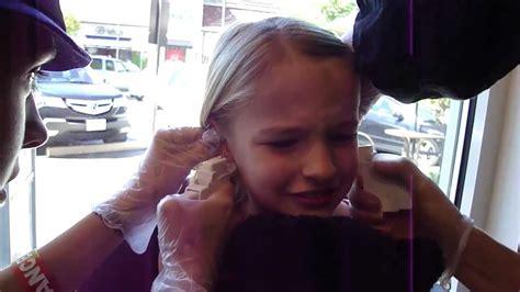 girls ear piercing youtube