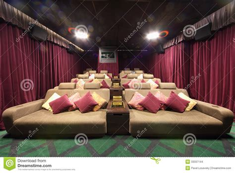 small hall  cinema  soft couches  pillows stock